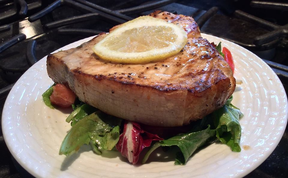 Grilled Swordfish Steak atop Greens
